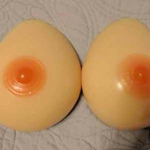 a close up of the two breast forms laying face up