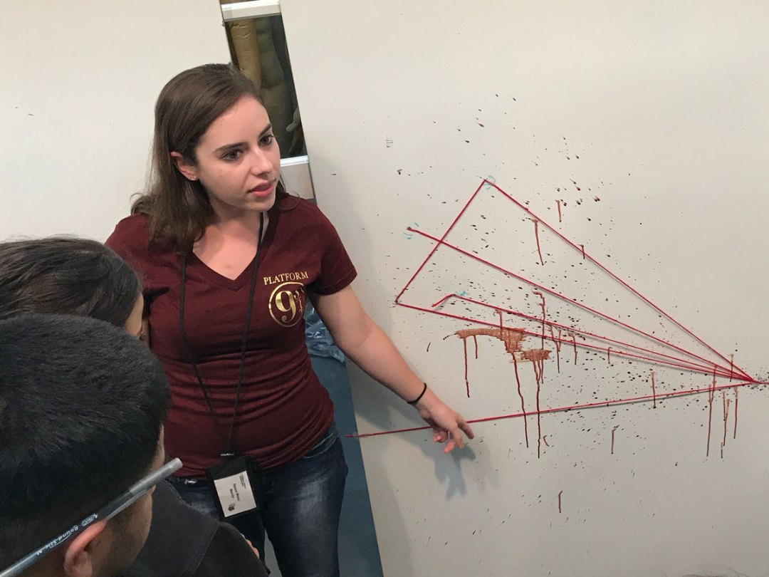 Students learn about blood spatter analysis in the Hertzberg-Davis Forensic Science Center.