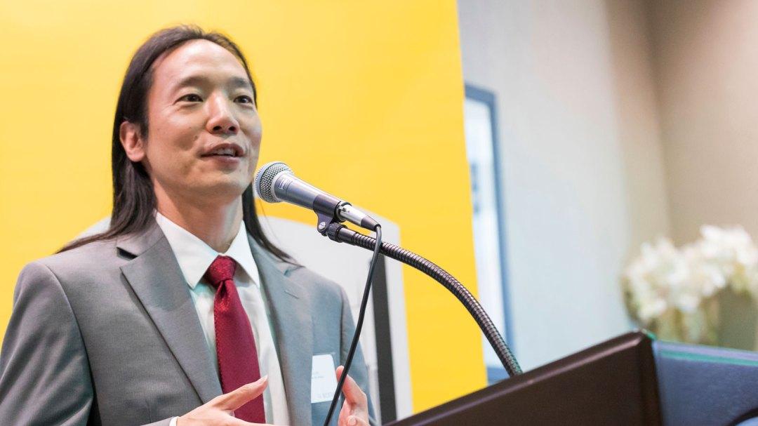 John Chi speaks at the 2017 LA BioStart graduation.