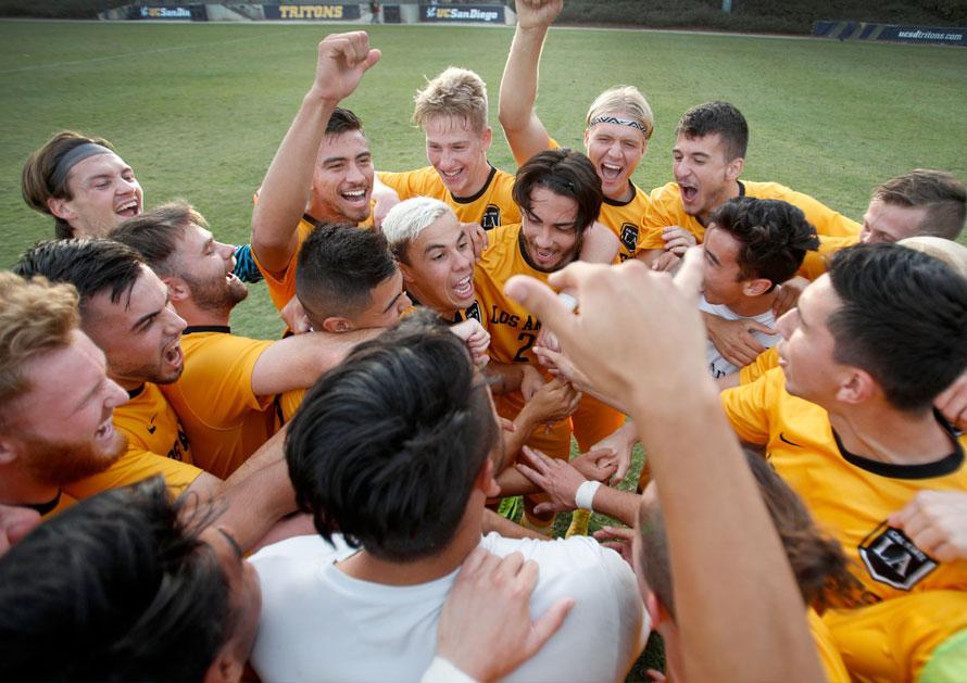 Student soccer atheletes celebrating