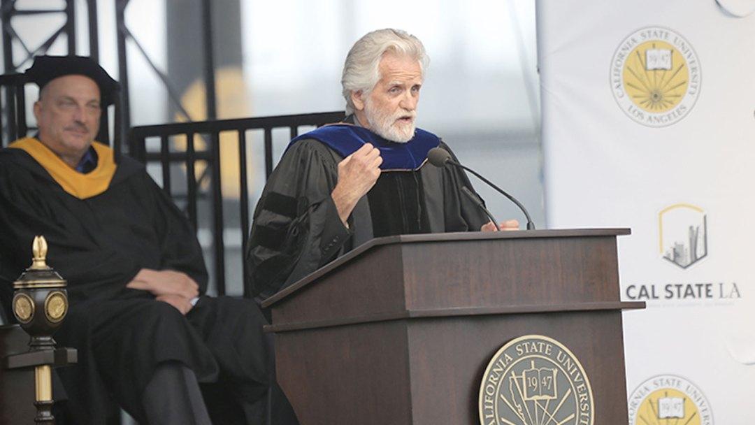 Alumni and artist, Kent Twitchell at graduation ceremony