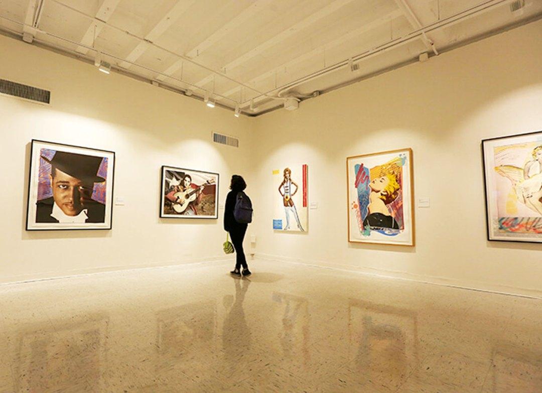 Person exploring Richard Duardo art exhibit