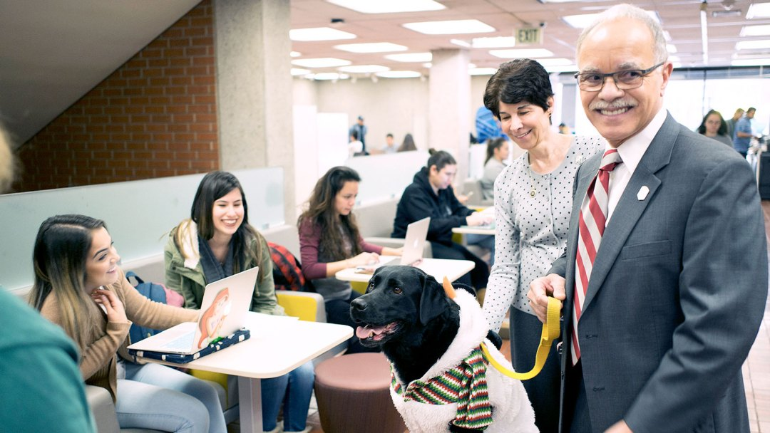 President Covino and First Lady Covino with Mind Matters dogs
