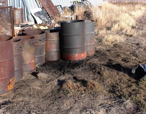 Contaminated Soil From Improper Used Oil Drum Storage identified during a facility environmental inspection