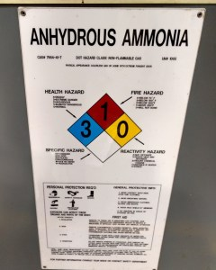 Sign with hazardous classification for Anhydrous Ammonia storage