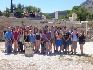 This is our whole group standing in front of the Bema in Corinth. The Bema was located along one side of the agora and was a place for city officials to hear from citizens. It was not a court, however, they did judge people accused of treason here or reward those who had done good service for the Emperor. The stone pillar you see is where the individual to be rewarded or punished would stand. If punished they would be chained to that pillar and whipped in front the whole city. Acts 18:12-17 happened on this spot.