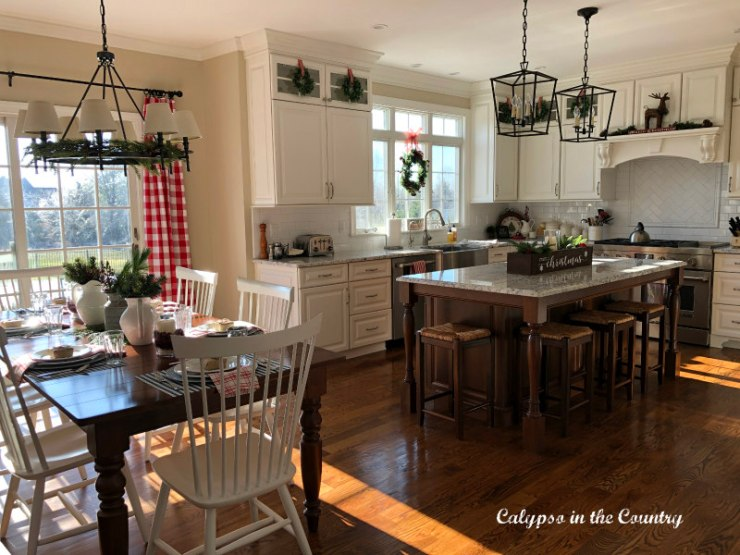White kitchen decorated with red for Christmas
