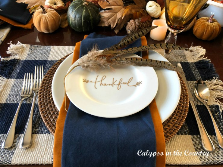 Thankful plate on Thanksgiving table