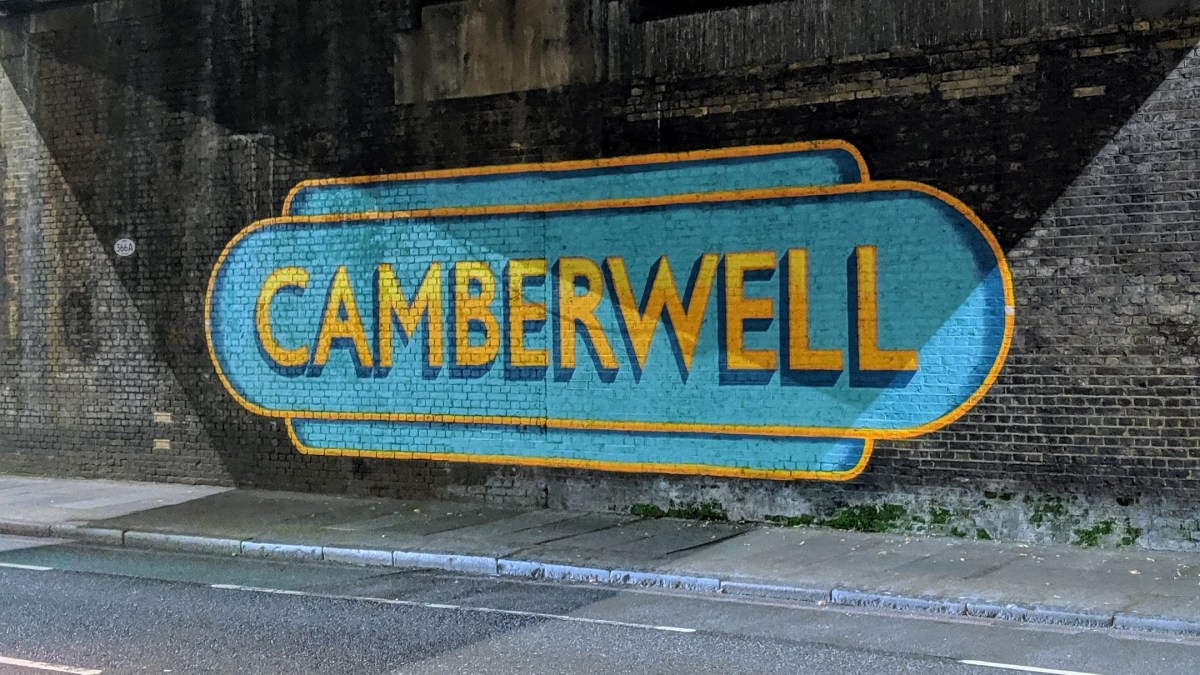 "A sign reading ""Camberwell"" painted on a wall"