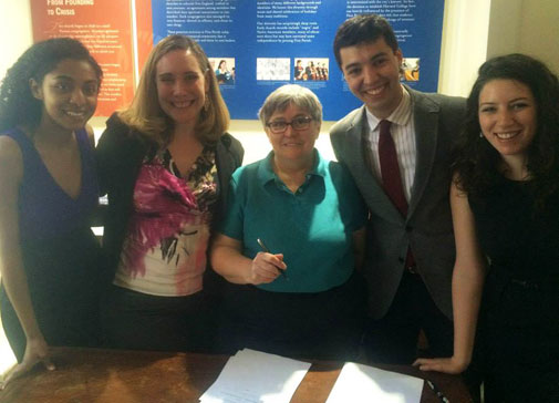 Y2Y Harvard Square shelter founders Sarah Rosenkrantz and Sam Greenberg at an April lease signing with the First Parish in Cambridge's Susan Shepherd, center.