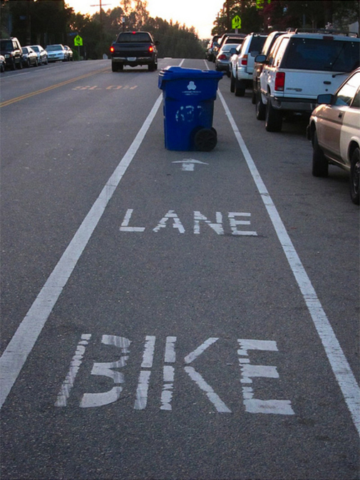 bike lane with trash can blockage