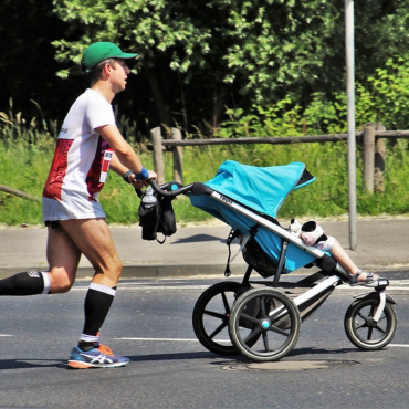 Father running with baby carriage