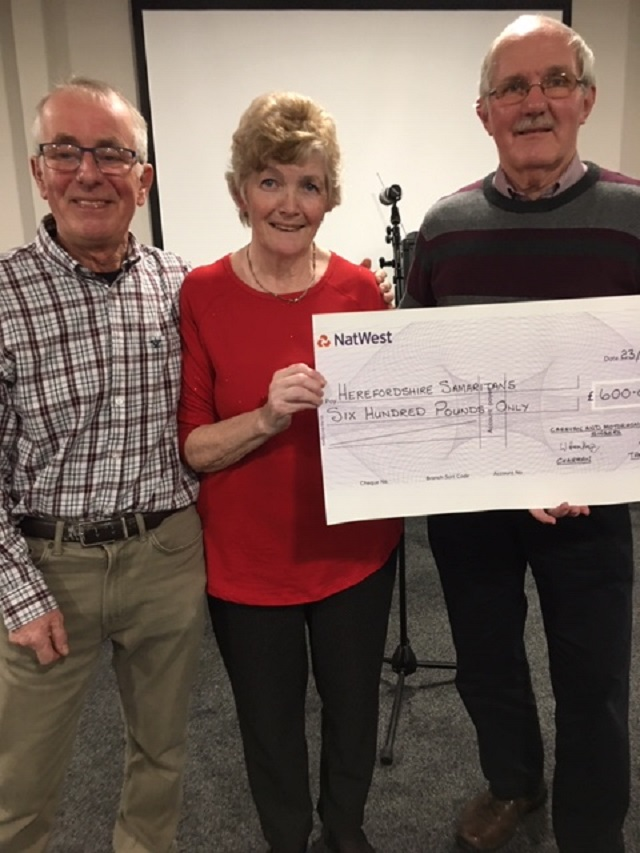 Charity cheque being presented to the Samaritans