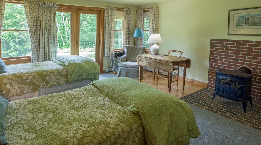 Larger side lower bedroom with gas stove and sliders