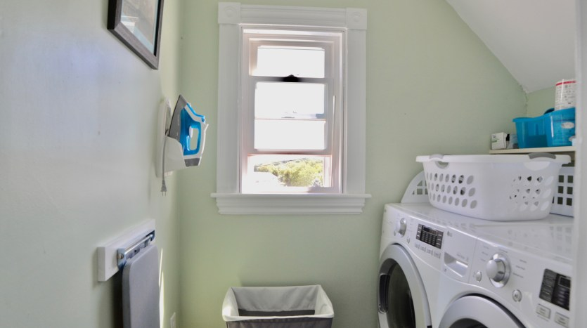 Laundry room with pull-out ironing board