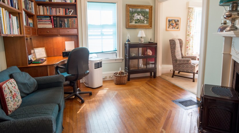 Study with desk, couch and gas log stove