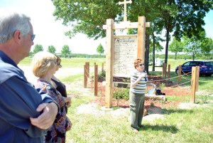 (The Lake Today: Samantha Edmondson) Valerie Thomas, Camden County Historical Society archivist and Mace Graveyard renovation project leader, tells the crowd at the Mace Graveyard rededication ceremony Sunday in Linn Creek of how the project started and was completed.