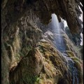 Vulci stalactite cliff and waterfall