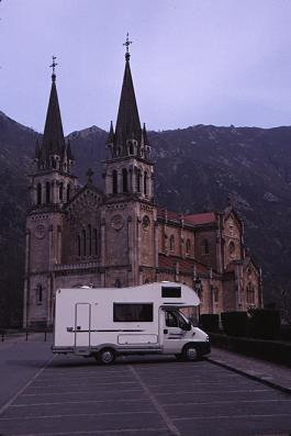 The motor home in front of the Covadunga Cathedral in Los Picos de Europa
