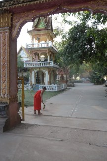 Monk sweeping at the Monastery