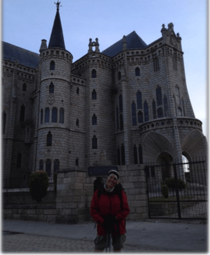 Christine is standing outside our accommodation, and for those not easily conned (it was not our accommodation) and well read it is the Palicio Espiscolpal designed by Gaudi. Pic is a bit dark as it was 7am.