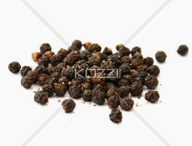 A Pile Of Peppercorns Isolated On White