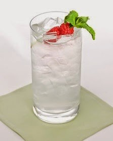 Winter Solstice (1 1/2 Ounces Orange Vodka 1/2 Ounce Orange-Flavored Liqueur, Such As Cointreau 1/2 Ounce Freshly Squeezed Lemon Juice, Preferably From Meyer Lemons Ice Cubes Club Soda, Chilled 1 Mint Leaf, For Garnish 1 Raspberry, For Garnish)