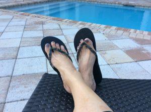 camo flipflops at pool