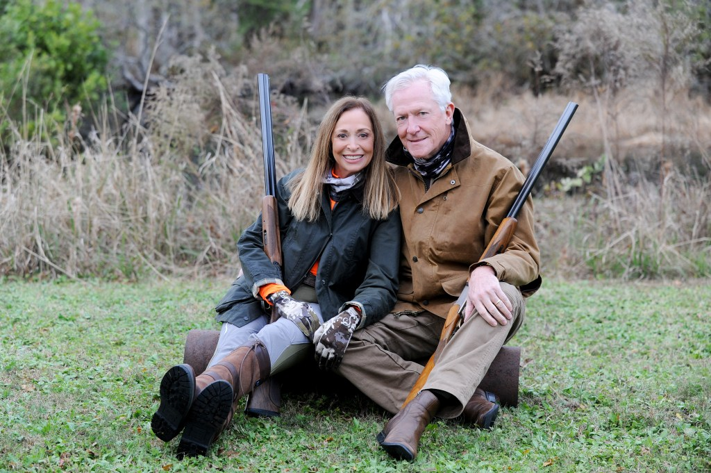 hunting couple with guns