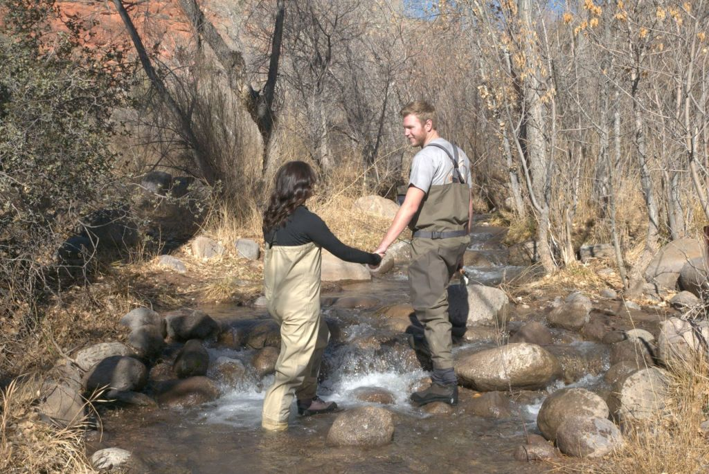 couple wading in river