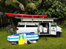 photo of rv camper van in hawaii with surfboards