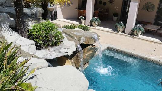 A view from above. Watch the waterfall cascade gently into the pool below.