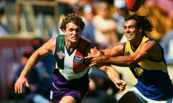 AFL - 22 blokes with mullets chasing a seagull.