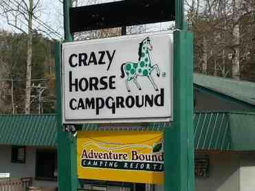 Adventure Bound Camping Resorts Crazy Horse Campground in Gatlinburg Tennessee Sign