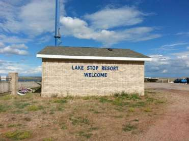The Lake Stop Resort north of Buffalo Wyoming Sign