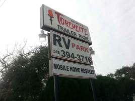 Torchlite RV Park in Clermont Florida Sign