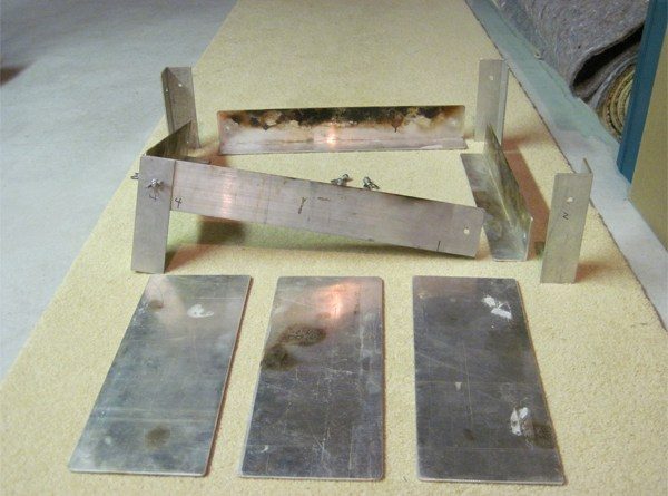 The individual pieces of the firepan.