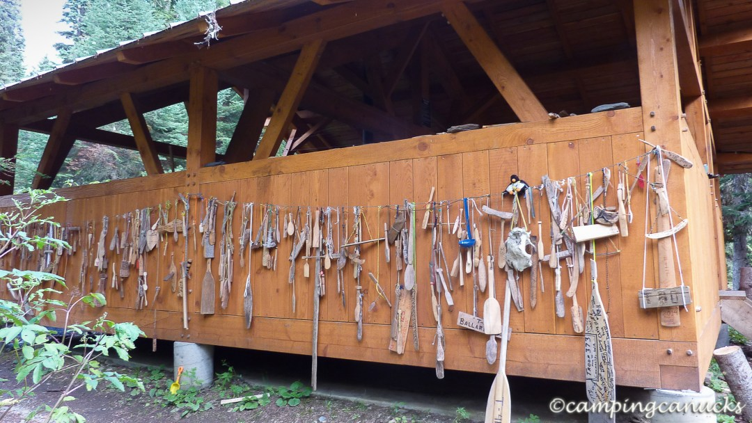 Some of the many carved paddles at a shelter near the Isaac River