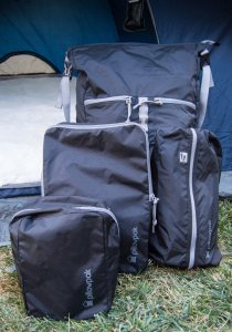 all four bags in front of the tent