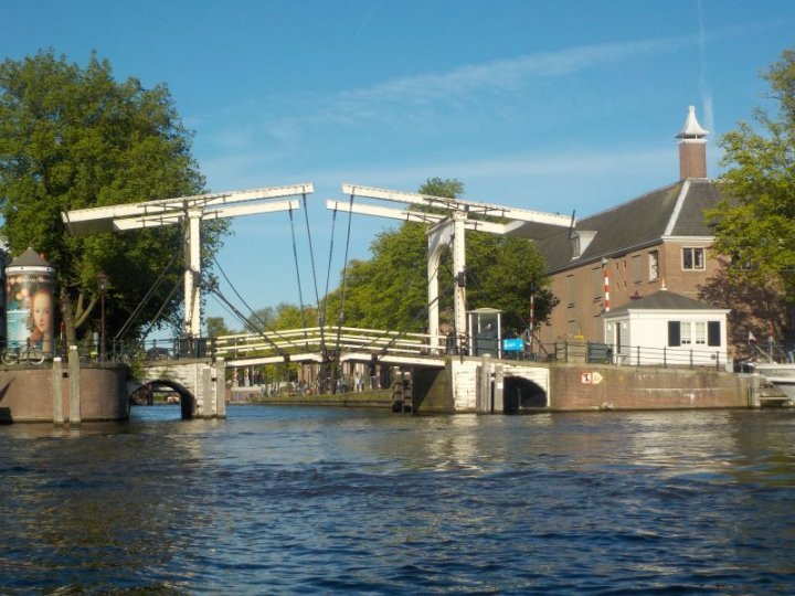 One of the many draw bridges to allow road and canal traffic through.