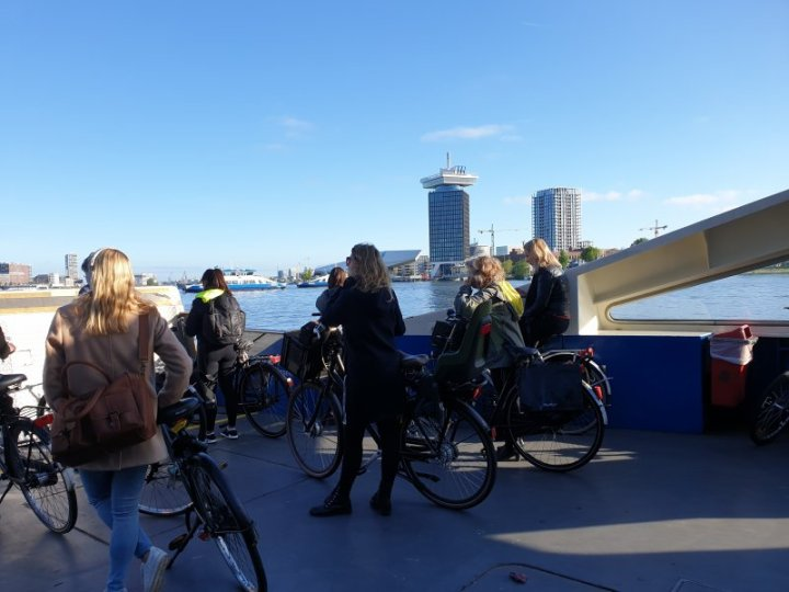 Cyclists on the deck of the ferry commuting to/from work.