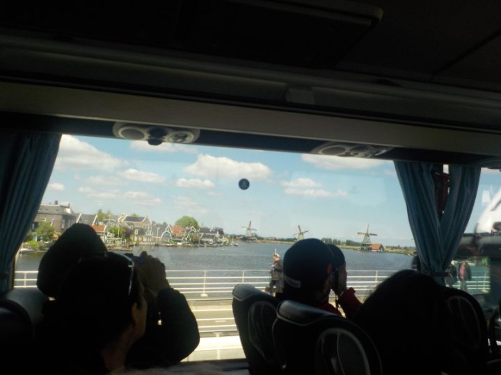 Arriving at Zaanse Schans via coach crossing the Zaan River from the village of Zaandijk.
