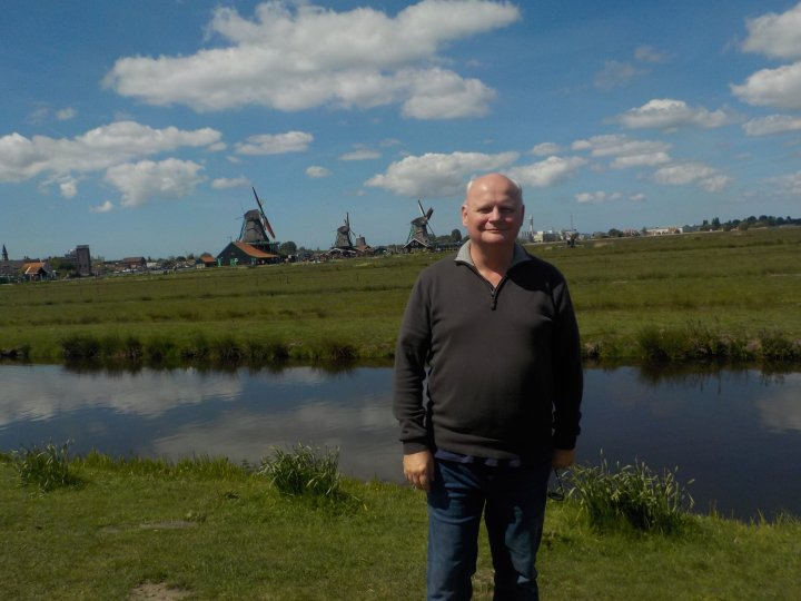 James standing in front of one of the canals near the entrance to Zaanse Schans village