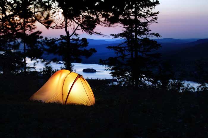 Tent Lit up (Shutterstock, Mikael Damkier)
