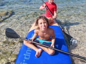 kids-sitting-on-paddle-board