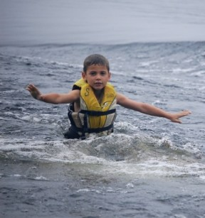 First-time up on water skis at Camp Takajo