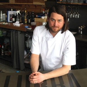 Nickolas Illingworth stands at fhe front counter of Lurra Cocina restaraunt at 1420 Locust in downtown Des Moines.