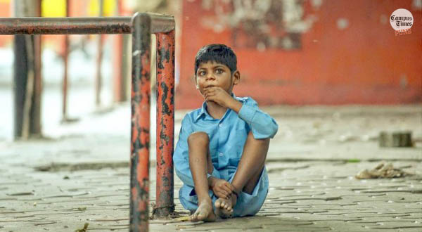 Deaf-Indian-Child-sitting-by-his-Bed