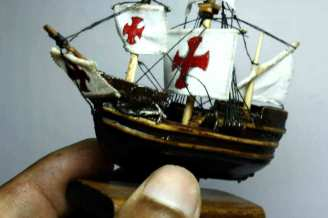 wooden-model-of-a-ship-with-a-red-cross