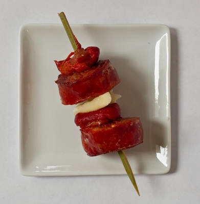 Chorizo-pepper skewers. Sauté thick slices of chorizo sausage until lightly browned. On short bamboo skewers, alternate chorizo and folded slices of roasted red pepper (and cheese, if desired).